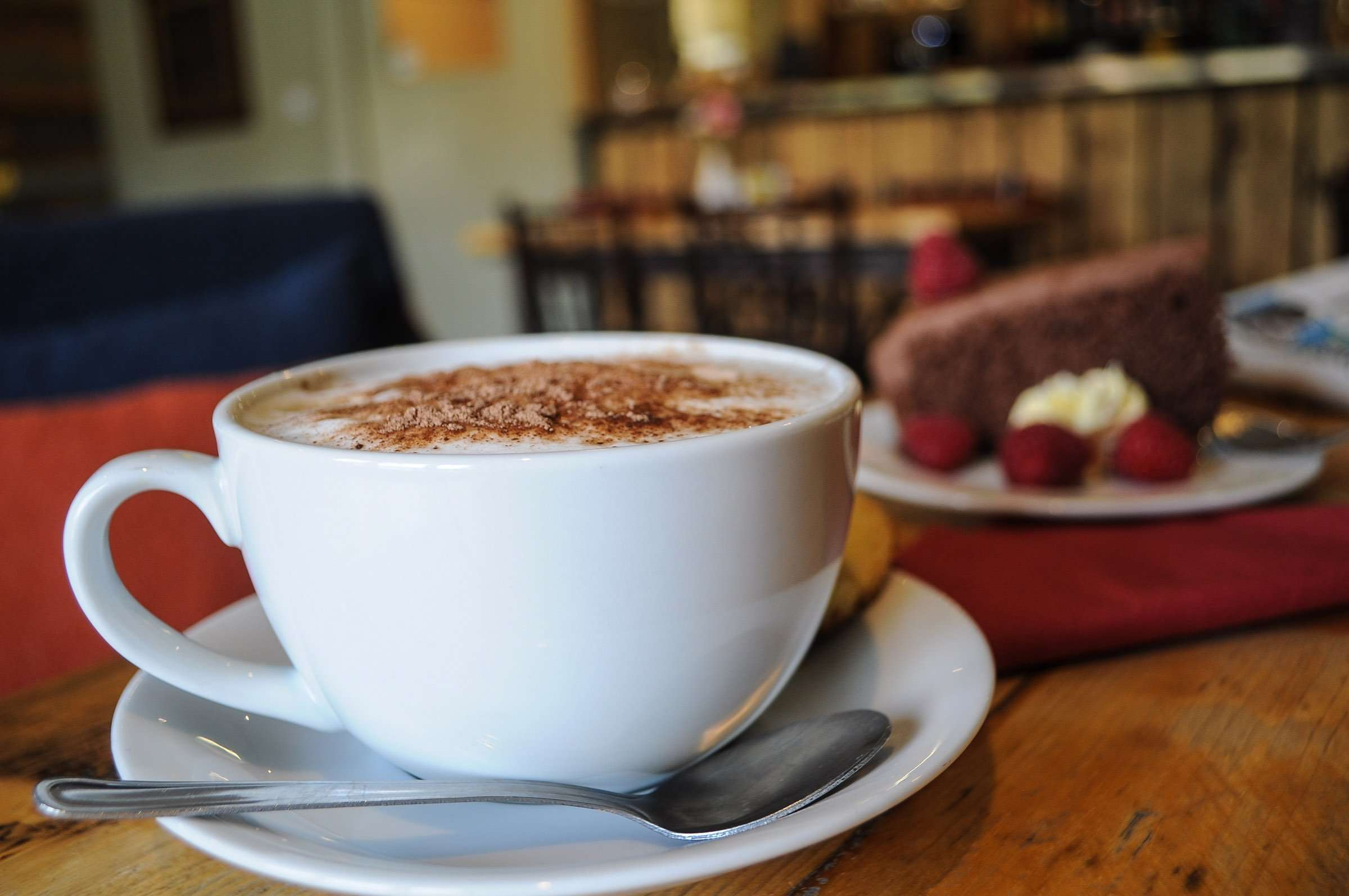 Hot coffee and freshly baked cake in café in Glencoe