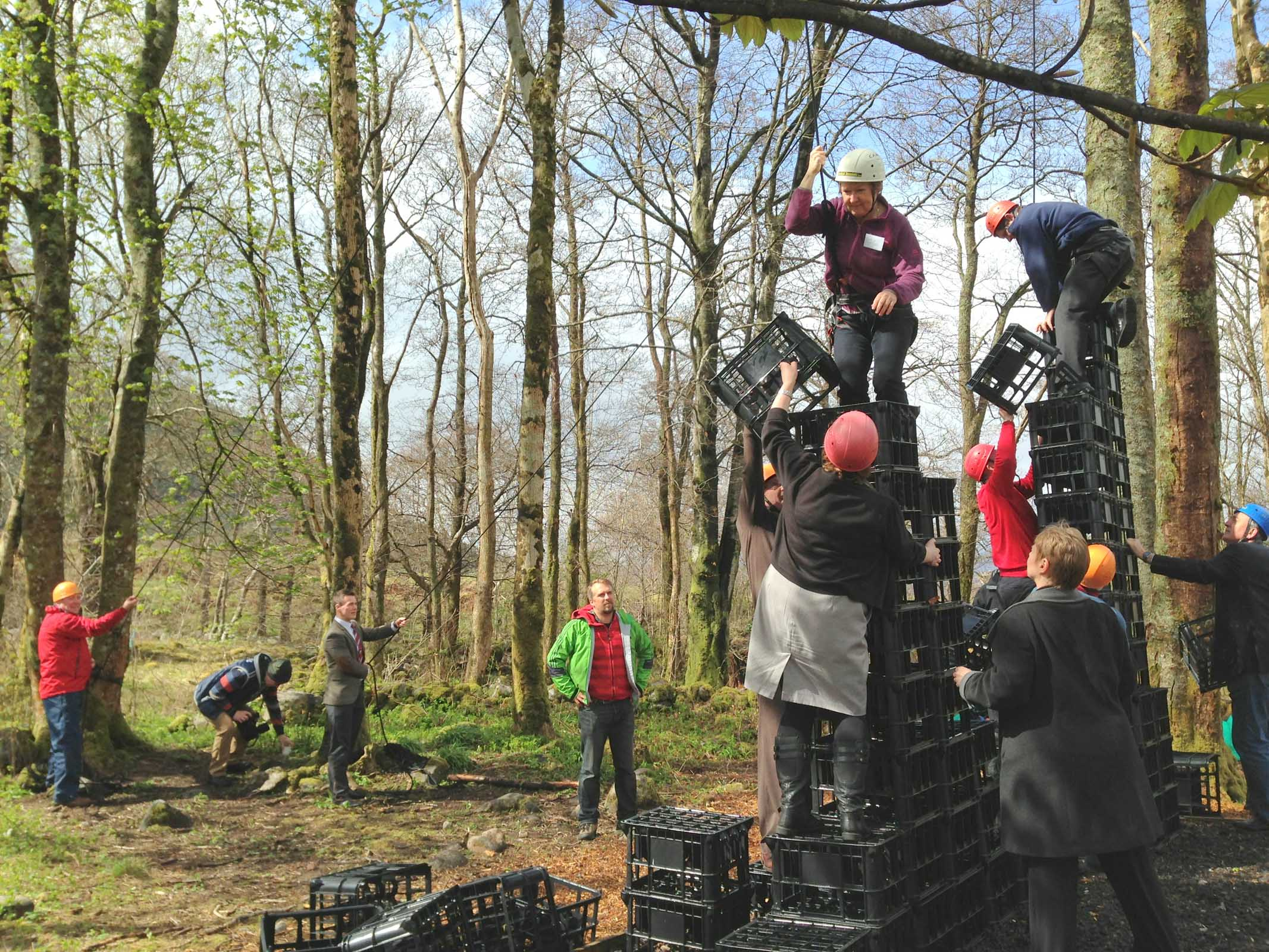 Family enjoys crate stacking fun at Woodlands Activity Centre, Glencoe, Scottish Highlands